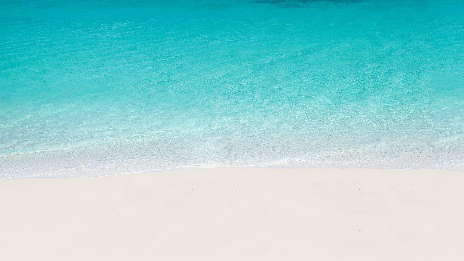 """Sprung zu Ankerpunkt #home-below. Key Visal von Trauminsel Reisen, Strand von Constance Tsarabanjina, Madagaskar, Weißer Sand und Türkises MeerLogo: """"Trauminsel Reisen - Nothing compares."""""""