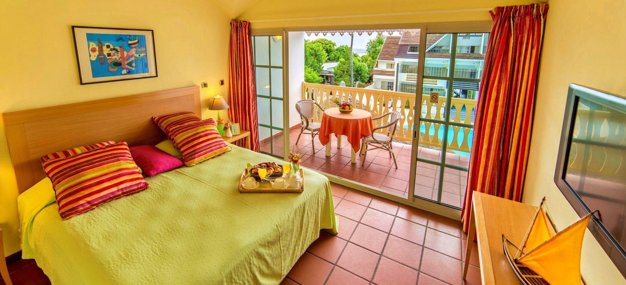 Ein Schlafzimmer im Hotel Le Nautile auf La Réunion